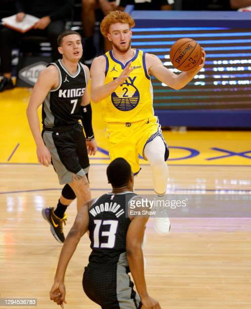 Nico Mannion of the Golden State Warriors dribbles past Kyle Guy of the Sacramento Kings at Chase Center on January 04, 2021 in San Francisco,...