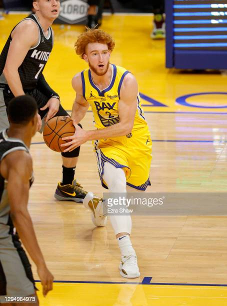 Nico Mannion of the Golden State Warriors dribbles the ball during their game against the Sacramento Kings at Chase Center on January 04, 2021 in San...
