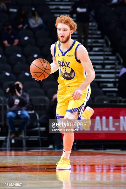 Nico Mannion of the Golden State Warriors handles the ball against the Phoenix Suns on March 4, 2021 at Talking Stick Resort Arena in Phoenix,...