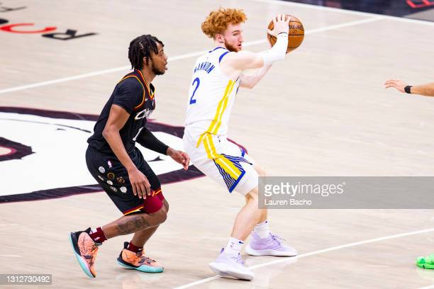 Nico Mannion of the Golden State Warriors handles the ball against Darius Garland of the Cleveland Cavaliers during the fourth quarter at Rocket...
