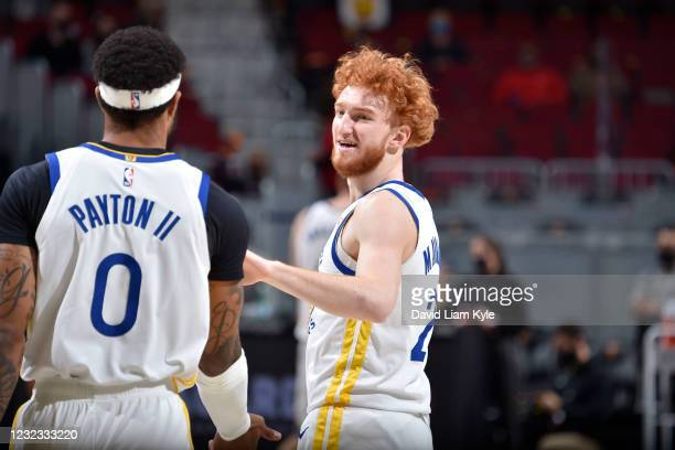 Nico Mannion of the Golden State Warriors high fives Gary Payton III of the Golden State Warriors during the game Cleveland Cavaliers on April 15,...