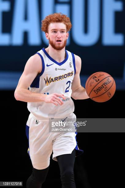 Nico Mannion of the Santa Cruz Warriors handles the ball against the Delaware Blue Coats on February 12, 2021 at AdventHealth Arena in Orlando,...