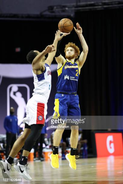 Nico Mannion of the Santa Cruz Warriors shoots three point basket against the Long Island Nets on February 27, 2021 at HP Field House in Orlando,...