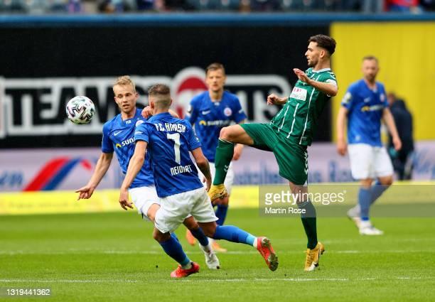 Nico Neidhardt of Hansa Rostock challenges Elsamed Ramaj of VfB Lübeck during the 3. Liga match between Hansa Rostock and VfB Lübeck at Ostseestadion...