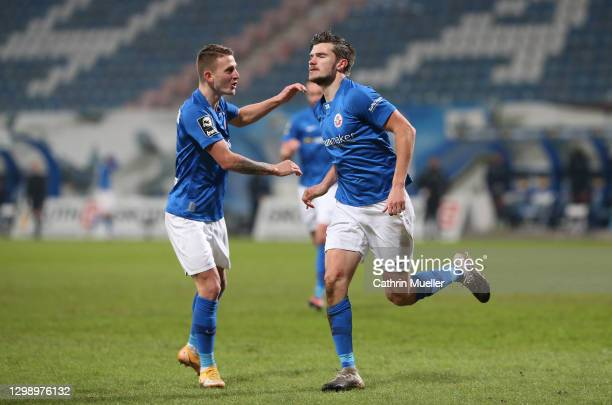 Nico Neidhart and Bjoern Rother of Hansa Rostock celebrate after scoring during the 3. Liga match between Hansa Rostock and 1. FC Saarbrücken at...