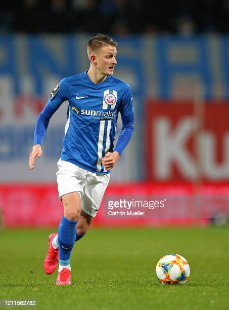 Nico Neidhart of Hansa Rostock runs with the ball during the 3 Liga match between Hansa Rostock and Eintracht Braunschweig at Ostseestadion on March...