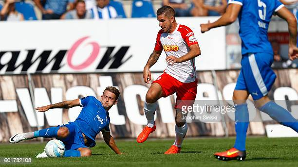 Nico Neidhart of Lotte challenges Marco Gruettner of Regensburg during the third league match between Sportfreunde Lotte and Jahn Regensburg at Frimo...