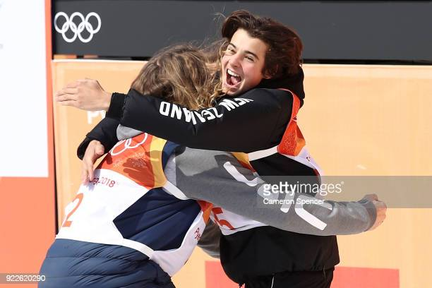 Nico Porteous of New Zealand celebrates with David Wise of the United States during the Freestyle Skiing Men's Ski Halfpipe Final on day thirteen of...