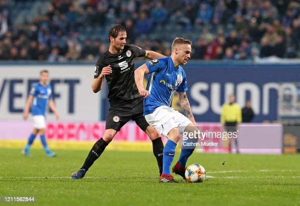 Nico Proschwitz of Eintracht Braunschweig and Nils Butzen of Hansa Rostock battle for the ball during the 3 Liga match between Hansa Rostock and...