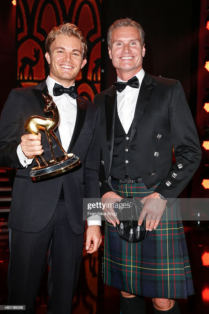 Nico Rosberg and David Coulthard pose after the Bambi Awards 2014 show on November 14, 2014 in Berlin, Germany.