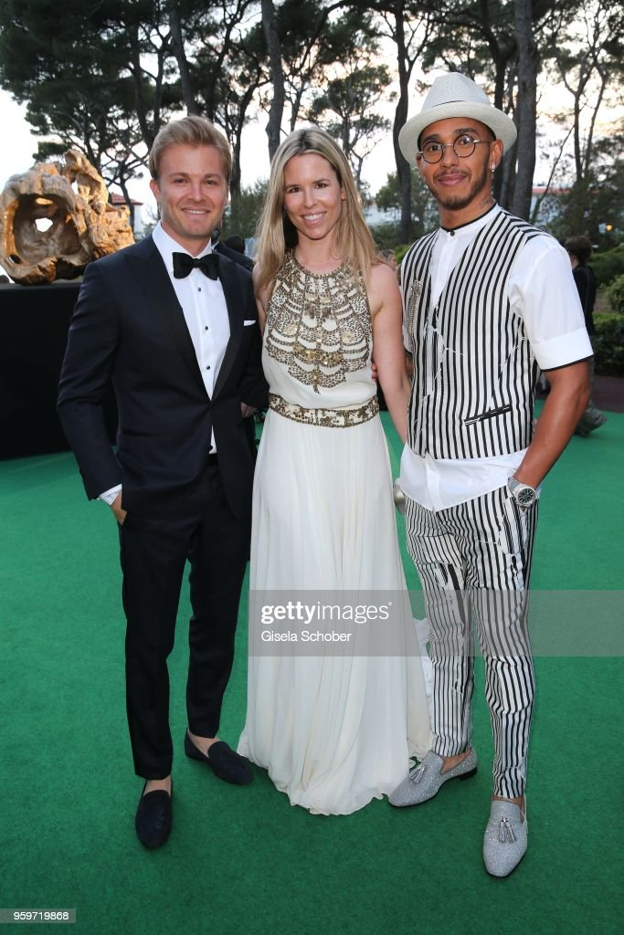 Nico Rosberg and his wife Vivian Rosberg and Lewis Hamilton during the cocktail at the amfAR Gala Cannes 2018 at Hotel du Cap-Eden-Roc on May 17, 2018 in Cap d'Antibes, France.
