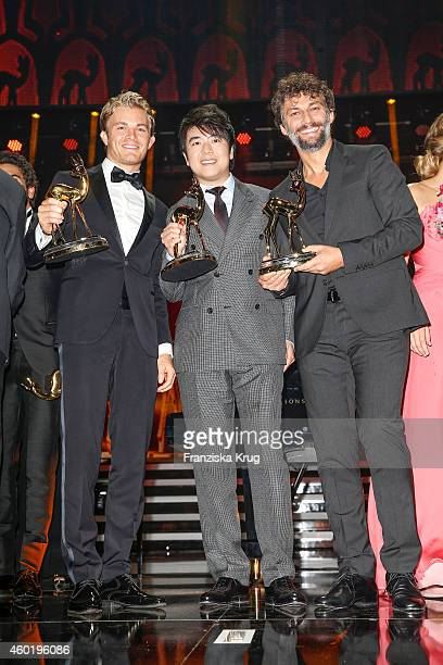 Nico Rosberg Lang Lang and Jonas Kaufmann pose with their awards after the Bambi Awards 2014 show on November 14 2014 in Berlin Germany