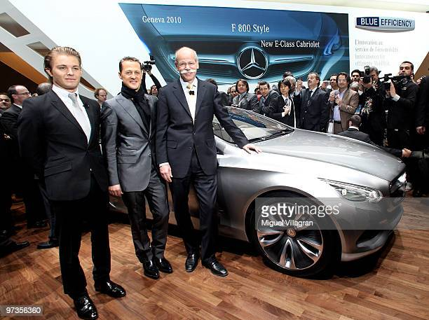 Nico Rosberg Michael Schumacher both of Germany and Mercedes GP and Dieter Zetsche chief executive officer of Daimler AG pose next to the Mercedes...