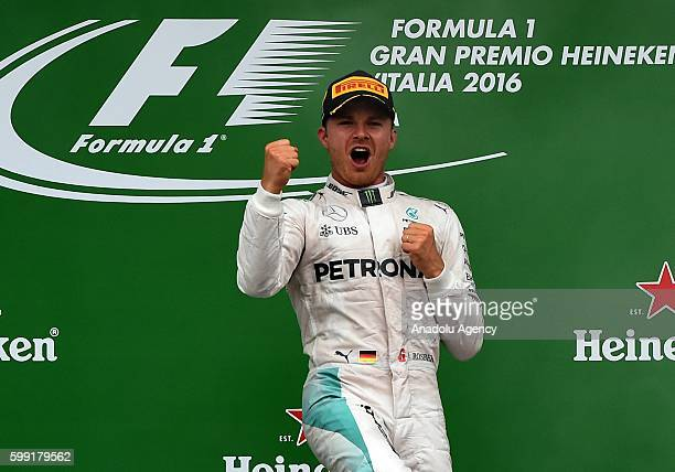 Nico Rosberg of Germany and Mercedes AMG Petronas F1 Team celebrates his first place on the podium during Formula One Grand Prix of Italy at...