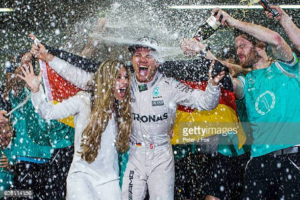 Nico Rosberg of Germany and Mercedes celebrates winning the F1 Drivers Championship with his Wife Vivian Sibold at the Abu Dhabi Formula One Grand...