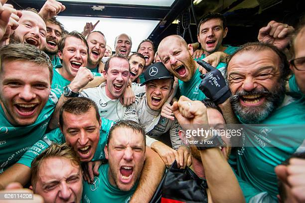 Nico Rosberg of Germany and Mercedes celebrates with his mechanics after winning the F1 Drivers World Championship during the Abu Dhabi Formula One...