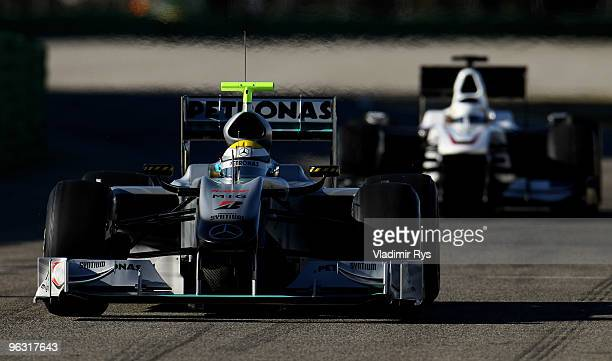 Nico Rosberg of Germany and Mercedes followed by Pedro De la Rosa of Spain and Sauber drives their cars at the Ricardo Tormo Circuit on February 1,...