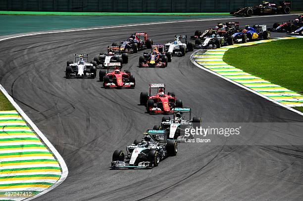 Nico Rosberg of Germany and Mercedes GP and Lewis Hamilton of Great Britain and Mercedes GP race into the second corner followed by the rest of the...