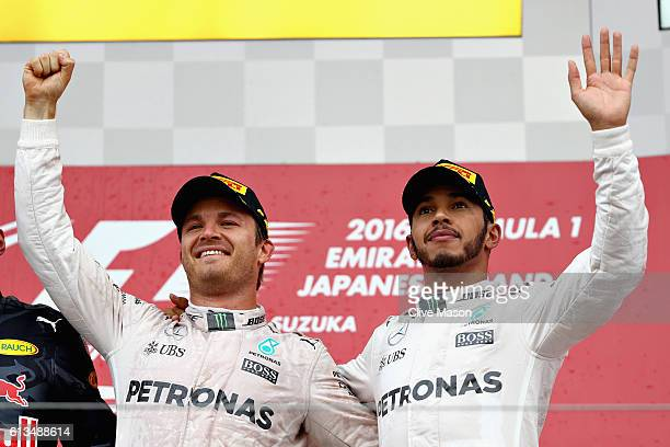 Nico Rosberg of Germany and Mercedes GP and Lewis Hamilton of Great Britain and Mercedes GP on the podium during the Formula One Grand Prix of Japan...