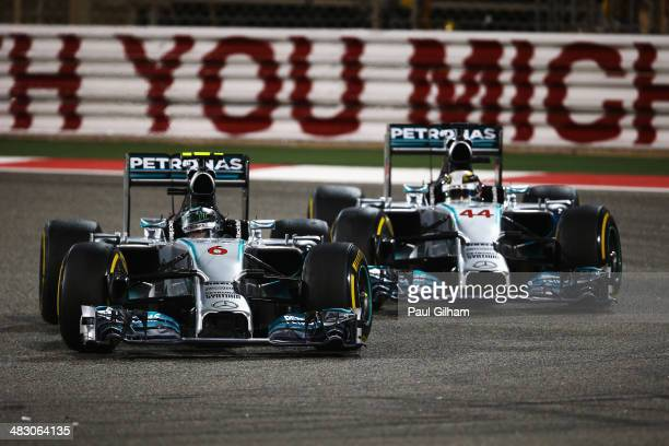 Nico Rosberg of Germany and Mercedes GP and team mate Lewis Hamilton of Great Britain and Mercedes GP battle for the lead during Bahrain Formula One...