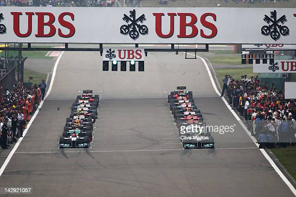 Nico Rosberg of Germany and Mercedes GP and team mate Michael Schumacher of Germany and Mercedes GP prepare to start in the Chinese Formula One Grand...