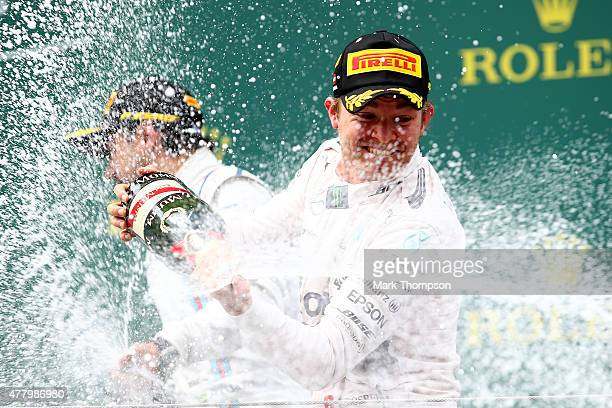 Nico Rosberg of Germany and Mercedes GP celebrate son the podium after winning the Formula One Grand Prix of Austria at Red Bull Ring on June 21 2015...