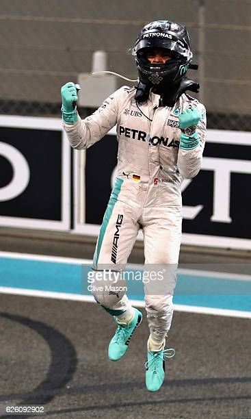 Nico Rosberg of Germany and Mercedes GP celebrates after finishing second and winning the World Drivers Championship during the Abu Dhabi Formula One...