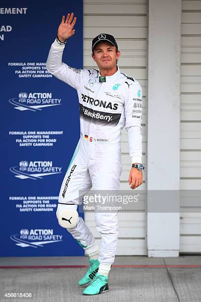 Nico Rosberg of Germany and Mercedes GP celebrates after securing pole position during Qualifying for the Japanese Formula One Grand Prix at Suzuka...