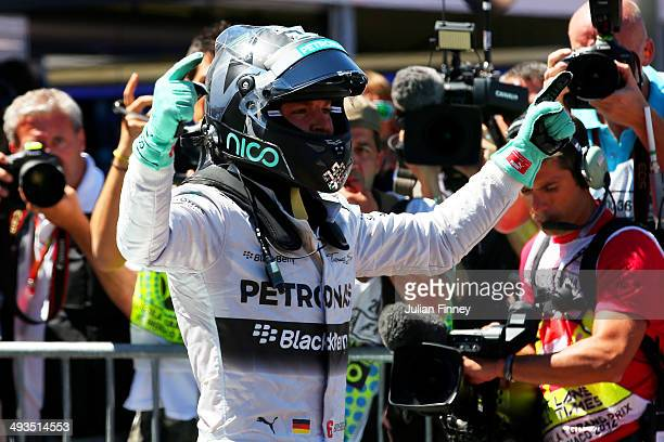 Nico Rosberg of Germany and Mercedes GP celebrates after securing pole position during qualifying ahead of the Monaco Formula One Grand Prix at...