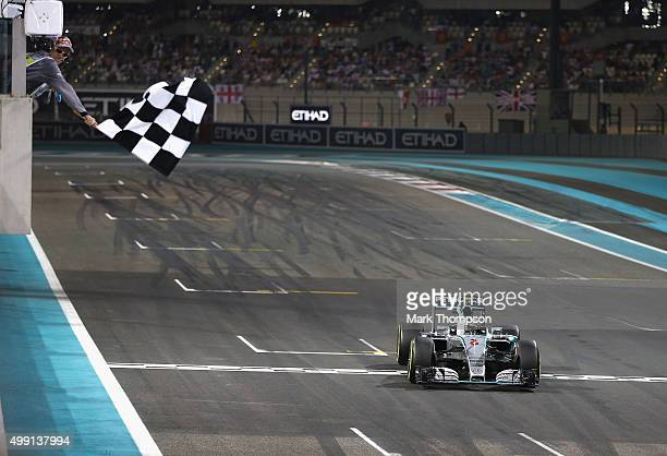 Nico Rosberg of Germany and Mercedes GP celebrates as he crosses the finish line to win the Abu Dhabi Formula One Grand Prix at Yas Marina Circuit on...