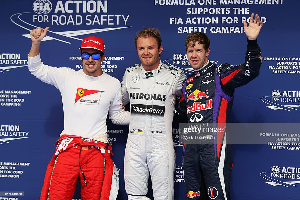 Nico Rosberg (C) of Germany and Mercedes GP celebrates finishing first alongside second placed Sebastian Vettel (R) of Germany and Infiniti Red Bull Racing and third placed Fernando Alonso (L) of Spain and Ferrari following qualifying for the Bahrain Formula One Grand Prix at the Bahrain International Circuit on April 20, 2013 in Sakhir, Bahrain.