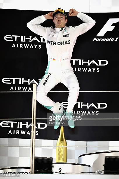 Nico Rosberg of Germany and Mercedes GP celebrates finishing second on the podium and winning the World Drivers Championship during the Abu Dhabi...