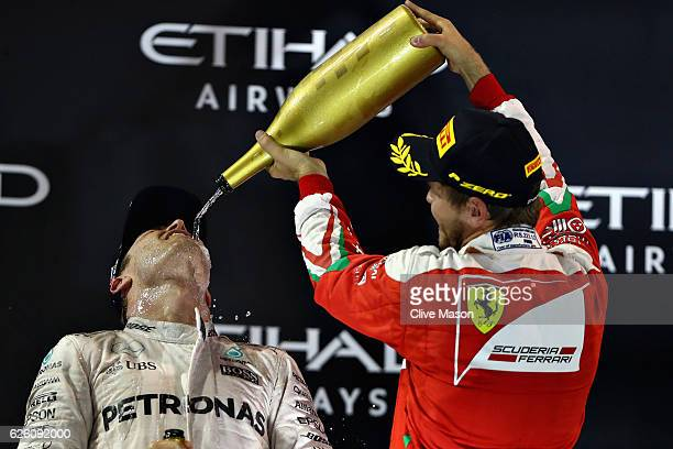 Nico Rosberg of Germany and Mercedes GP celebrates finishing second on the podium and winning the World Drivers Championship with third place...