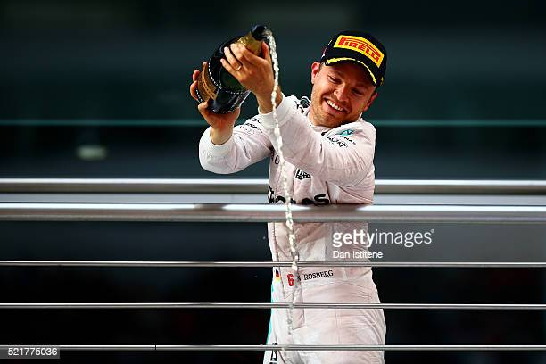 Nico Rosberg of Germany and Mercedes GP celebrates his victory on the podium during the Formula One Grand Prix of China at Shanghai International...
