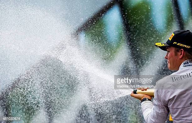 Nico Rosberg of Germany and Mercedes GP celebrates his win during the Austrian Formula One Grand Prix at Red Bull Ring on June 22, 2014 in Spielberg,...