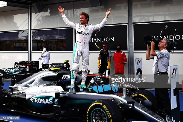 Nico Rosberg of Germany and Mercedes GP celebrates his win in parc ferme during the European Formula One Grand Prix at Baku City Circuit on June 19...