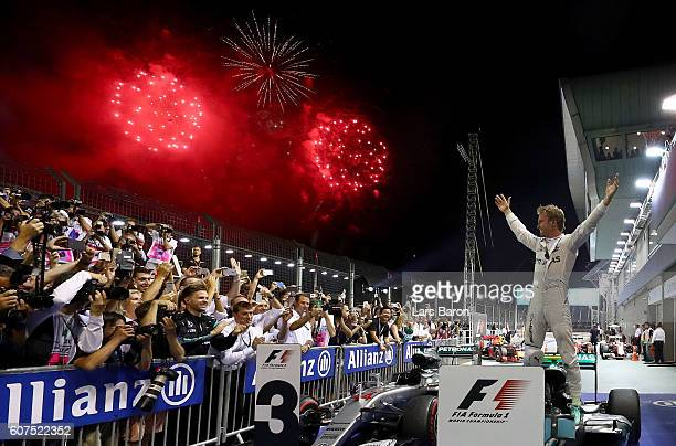 Nico Rosberg of Germany and Mercedes GP celebrates his win in parc ferme during the Formula One Grand Prix of Singapore at Marina Bay Street Circuit...