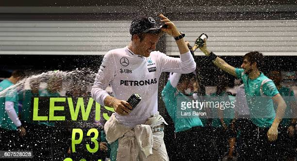 Nico Rosberg of Germany and Mercedes GP celebrates his win with his team during the Formula One Grand Prix of Singapore at Marina Bay Street Circuit...