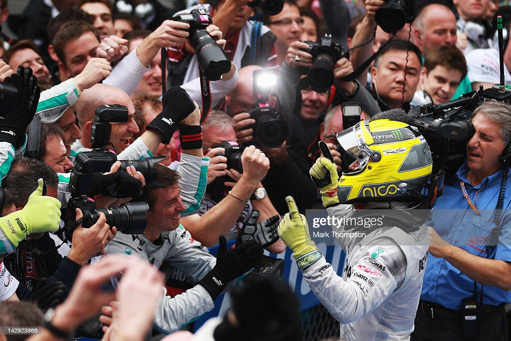 Nico Rosberg of Germany and Mercedes GP celebrates in parc ferme after winning the Chinese Formula One Grand Prix at the Shanghai International Circuit on April 15, 2012 in Shanghai, China.