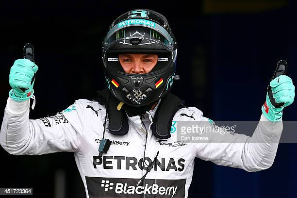 Nico Rosberg of Germany and Mercedes GP celebrates in Parc Ferme after claiming pole position during qualifying ahead of the British Formula One...