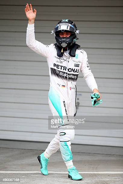 Nico Rosberg of Germany and Mercedes GP celebrates in Parc Ferme after claiming pole position during qualifying for the Formula One Grand Prix of...