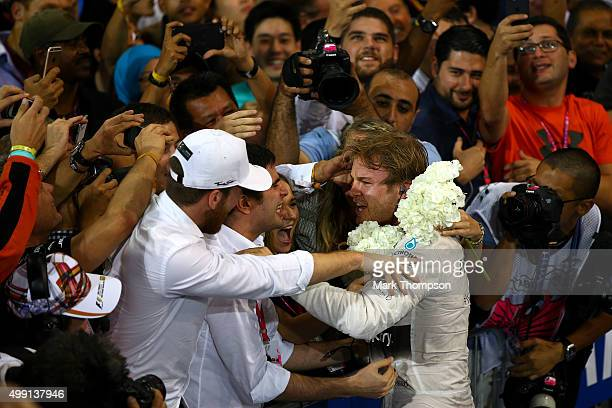 Nico Rosberg of Germany and Mercedes GP celebrates in Parc Ferme after winning the Abu Dhabi Formula One Grand Prix at Yas Marina Circuit on November...