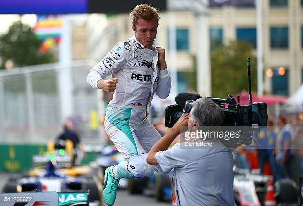 Nico Rosberg of Germany and Mercedes GP celebrates in parc ferme after winning the European Formula One Grand Prix at Baku City Circuit on June 19...