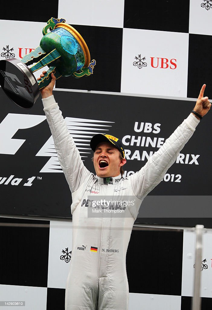 Nico Rosberg of Germany and Mercedes GP celebrates on the podium after winning the Chinese Formula One Grand Prix at the Shanghai International Circuit on April 15, 2012 in Shanghai, China.