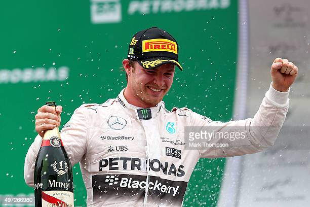 Nico Rosberg of Germany and Mercedes GP celebrates on the podium after winning the Formula One Grand Prix of Brazil at Autodromo Jose Carlos Pace on...