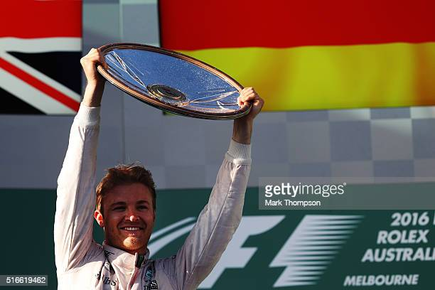Nico Rosberg of Germany and Mercedes GP celebrates on the podium during the Australian Formula One Grand Prix at Albert Park on March 20, 2016 in...
