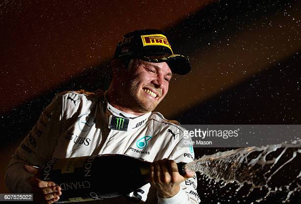 Nico Rosberg of Germany and Mercedes GP celebrates on the podium during the Formula One Grand Prix of Singapore at Marina Bay Street Circuit on...