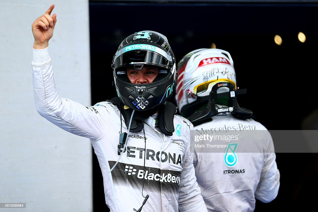 Nico Rosberg of Germany and Mercedes GP celebrates victory next to Lewis Hamilton of Great Britain and Mercedes GP after the Austrian Formula One Grand Prix at Red Bull Ring on June 22, 2014 in Spielberg, Austria.
