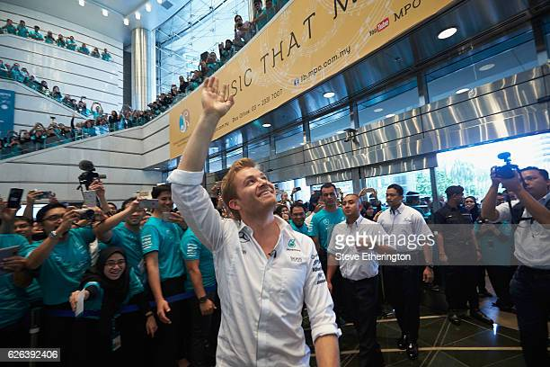 Nico Rosberg of Germany and Mercedes GP celebrates winning the F1 World Drivers Championship with Petronas staff on November 29, 2016 at the Petronas...