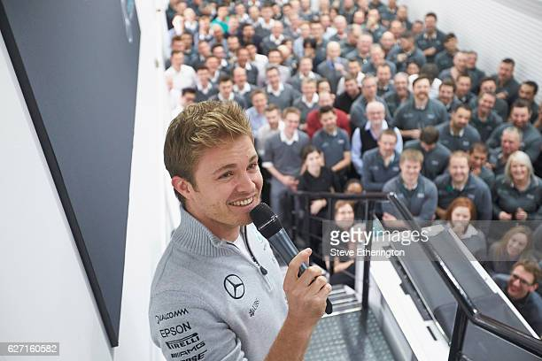 Nico Rosberg of Germany and Mercedes GP celebrates winning the F1 World Drivers Championship with Mercedes GP staff on December 1, 2016 in Brackley,...